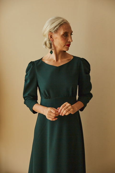 Midi dress with decorative assembly on the sleeve